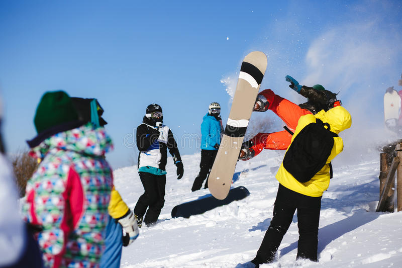 Download Jumping Snowboarder On Blue Sky Background Stock Photo - Image: 83706108