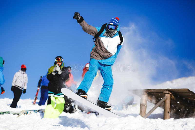 Download Jumping Snowboarder On Blue Sky Background Stock Photo - Image: 83706139