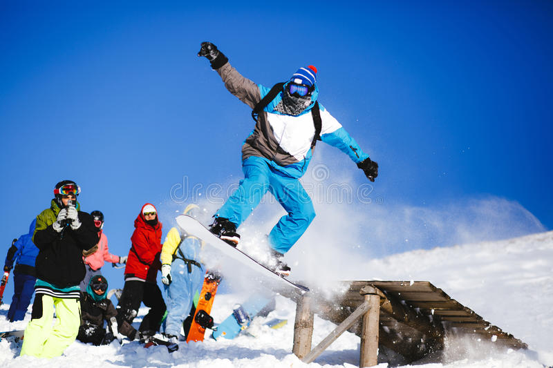 Download Jumping Snowboarder On Blue Sky Background Stock Image - Image of active, outdoors: 83707107