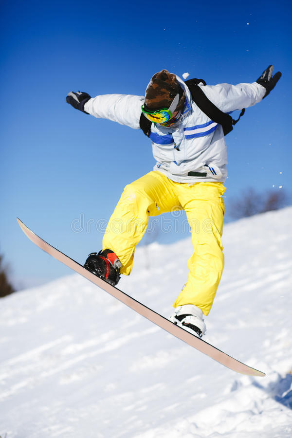 Download Jumping Snowboarder On Blue Sky Background Stock Image - Image: 83707189