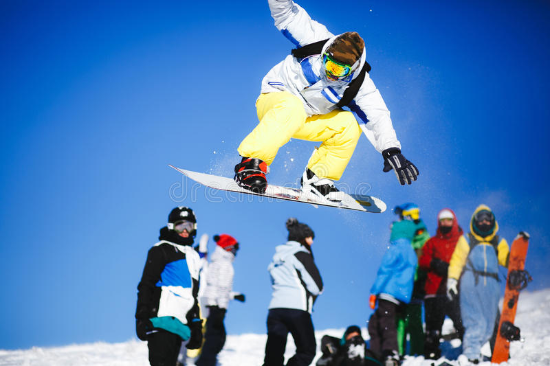 Download Jumping Snowboarder On Blue Sky Background Stock Photo - Image: 83707331