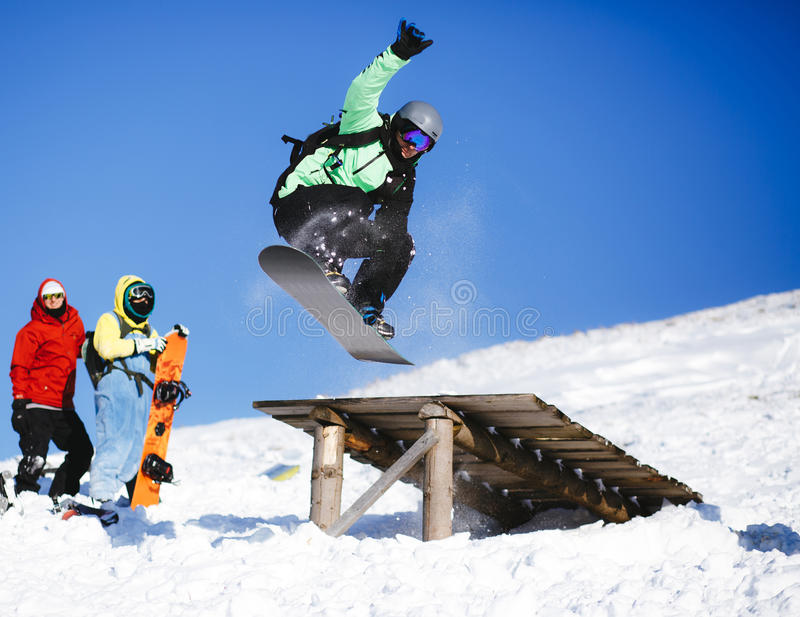 Download Jumping Snowboarder On Blue Sky Background Editorial Stock Photo - Image: 83705973