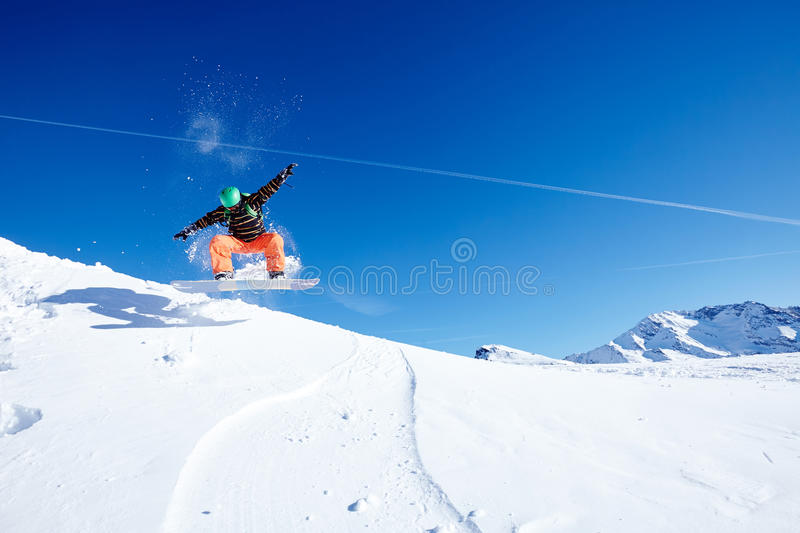 Jumping snowboarder royalty free stock photography
