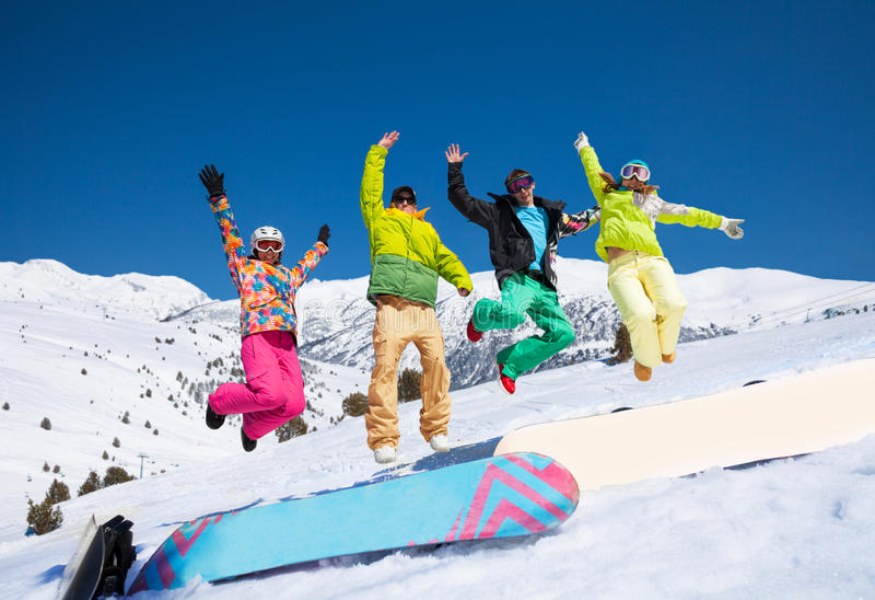 Jumping snowboarders stock photography