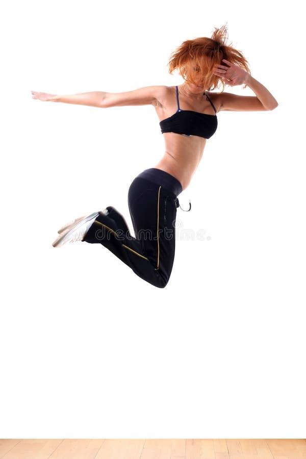 Jumping sport dancer in ballroom. Jumping woman modern sport dancer in ballroom royalty free stock photography