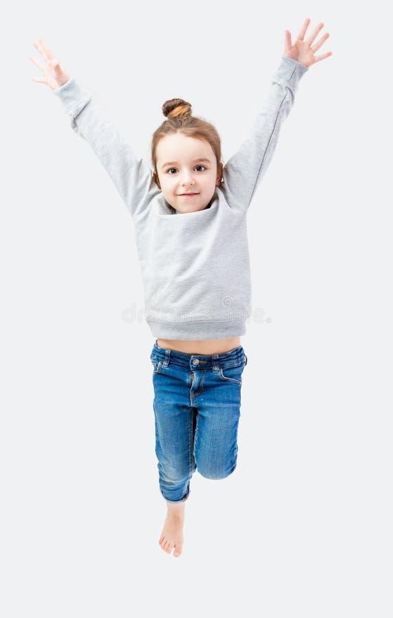 Jumping sporty little girl stock photos