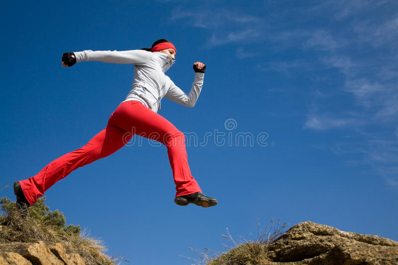 Download Jumping sporty woman stock image. Image of practice, outdoor - 13877327