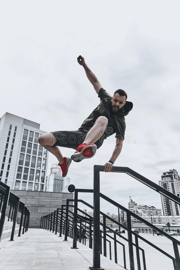 Jumping straight over any obstacles. royalty free stock photography