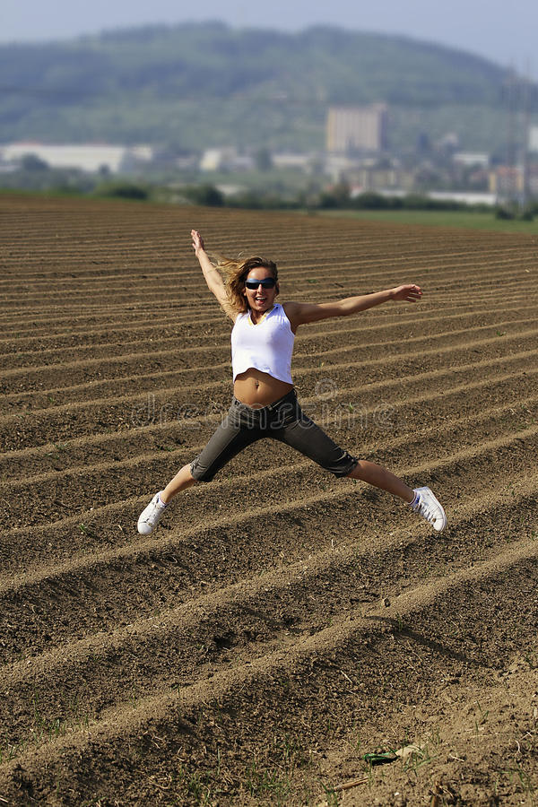 Download Jumping teen stock image. Image of lively, field, soil - 26209881
