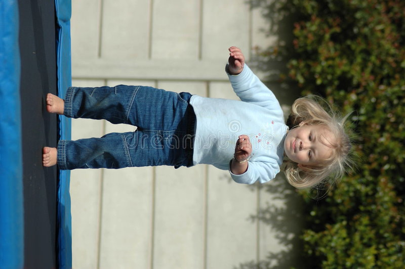 Jumping toddler royalty free stock photos