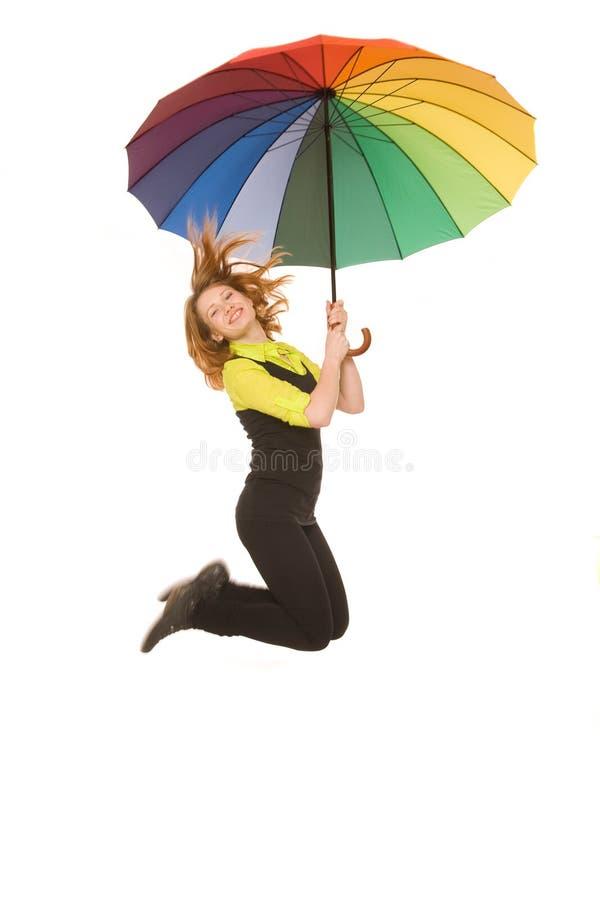 Jumping with umbrella stock photo