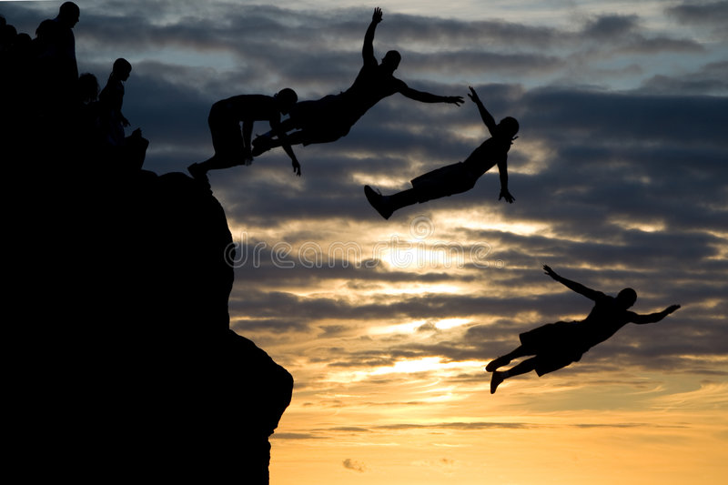 Jumping in Waimea Bay. Combined images of a man jumping off a rock in Waimea Beach stock image
