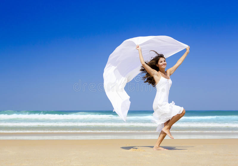 Jumping with a white scarf stock photo