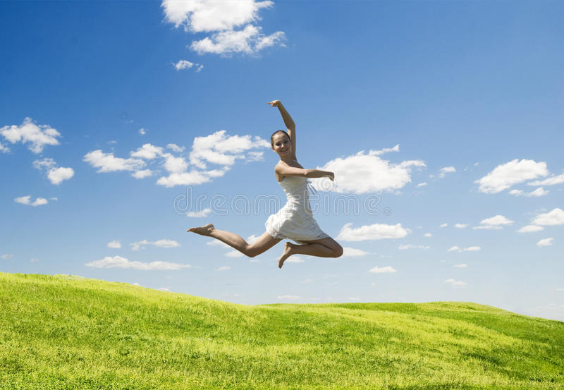 Jumping woman royalty free stock photography