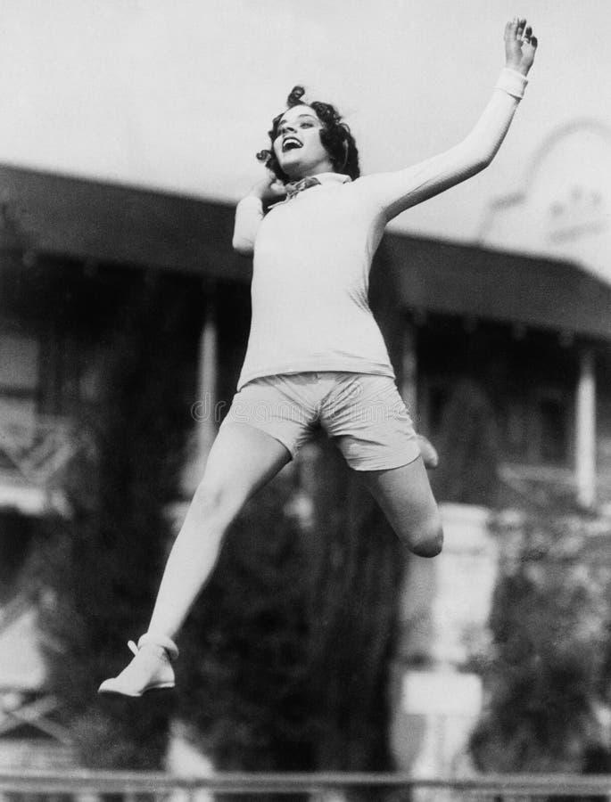 Free Jumping Woman In Midair Stock Photos - 52012693
