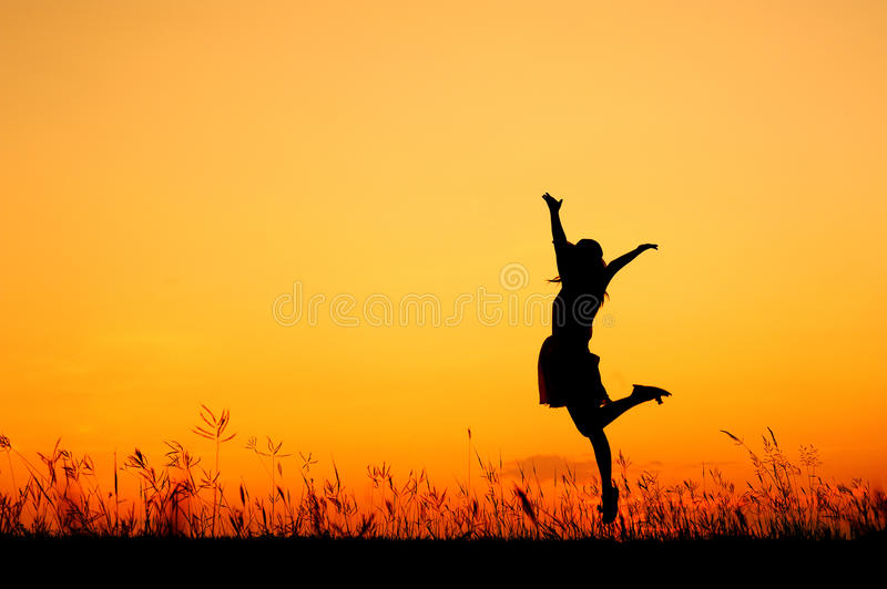 Download Jumping Woman And Sunset Silhouette Stock Photo - Image: 25243044