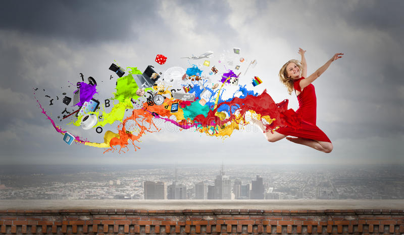 Jumping woman. Young woman dancer in red dress jumping high stock photos