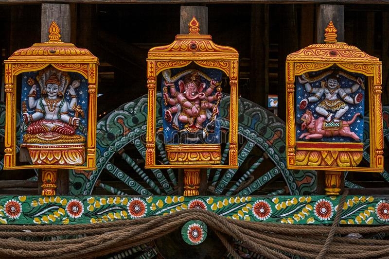 Vishnu Ganesh and Shivastatues at wheel of chariot rath yatra of jagannath ; Puri ; Orissa ; India. 24-jun-200 Vishnu Ganesh and Shivastatues at wheel of chariot royalty free stock photo