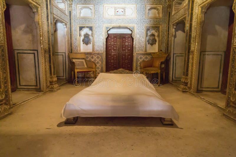 Junagarh Fort interior, Bikaner, India. BIKANER, INDIA - OCTOBER 12, 2015: Maharaja's bedroom with gold decorated gold walls and doors inside 16th century stock images
