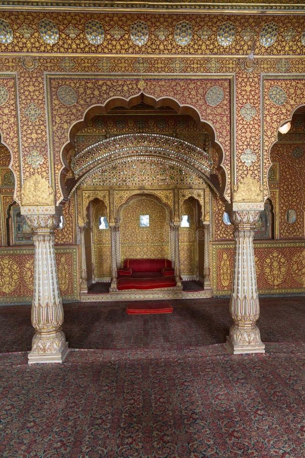 Junagarh Fort interior, Bikaner, India. BIKANER, INDIA - OCTOBER 12, 2015: Maharaja's resting room with arches in gold patterns inside 16th century Junagarh Fort royalty free stock images