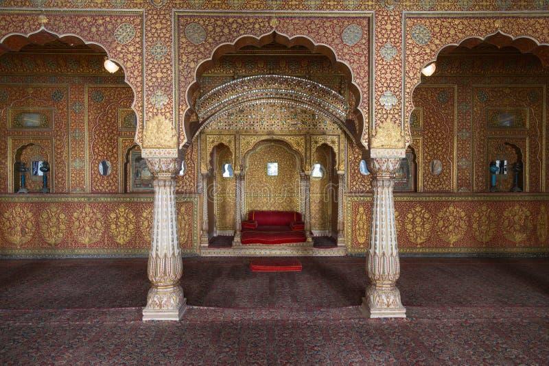 Junagarh fort interior, Bikaner, India. BIKANER, INDIA - OCTOBER 12, 2015: Maharaja's resting room with arches in gold patterns inside 16th century Junagarh Fort royalty free stock photo