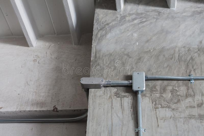 Junction box for electrical wiring. On concrete wall stock photos