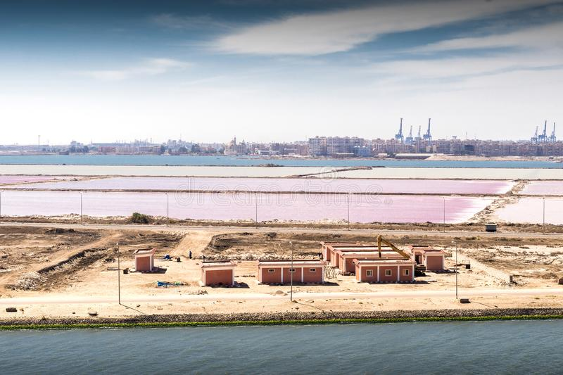 The junction of the Suez Canal into the Mediterranean at Port Sa. Id and Port Fouad with their saltworks stock image