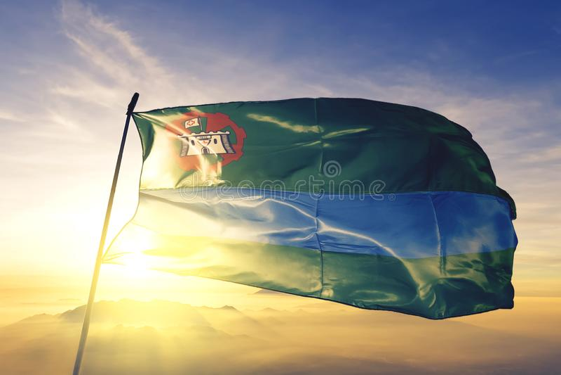 Jundiai of Brazil flag waving on the top sunrise mist fog. Jundiai of Brazil flag textile cloth fabric waving on the top sunrise mist fog royalty free stock image