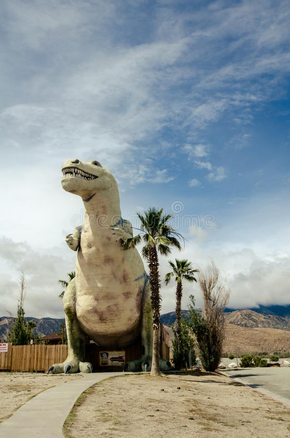 CABAZON, CALIFORNIA: A t-rex statue dinosaur at a roadside attraction. CABAZON, CALIFORNIA: A t-rex statue looks up into the cloudy sky at the Cabazon Dinosaurs stock photography
