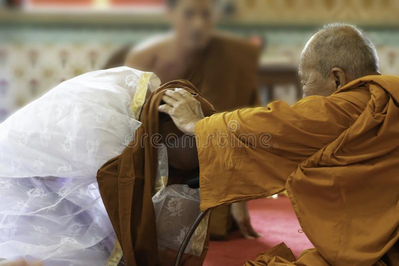 June 24 2018: Chonburi, Thailand: A old priest gave a monk robe royalty free stock image