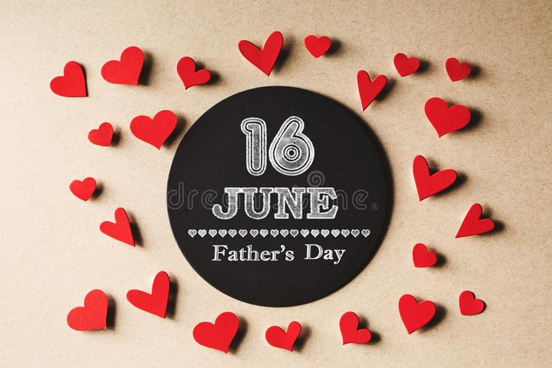 16 June Fathers Day message with small hearts. 16 June Fatehrs Day message with handmade small paper hearts royalty free stock image