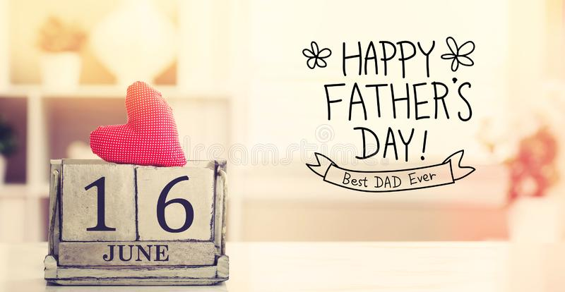 16 June Happy Fathers Day message with calendar. 16 June Happy Fathers Day message with wooden block calendar stock image