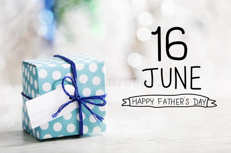 16 June Happy Fathers Day  message with gift box. 16 June Happy Fathers Day message with small handmade gift box stock photos
