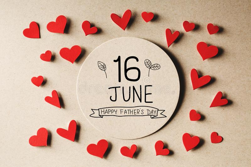 16 June Happy Fathers Day message with small hearts. 16 June Happy Fathers Day message with handmade small paper hearts stock image