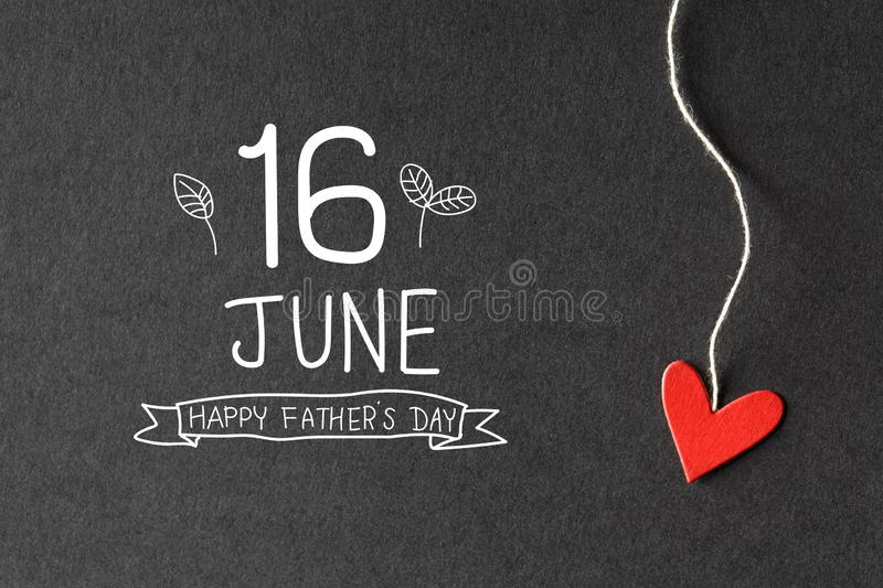 16 June Happy Fathers Day message with paper hearts. 16 June Happy Fathers Day message with handmade small paper hearts stock image