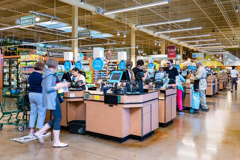 June 21, 2019 Los Altos / CA / USA - Whole Foods store cash register check out lanes, south San Francisco bay area; Amazon Prime. Members save more messages stock image