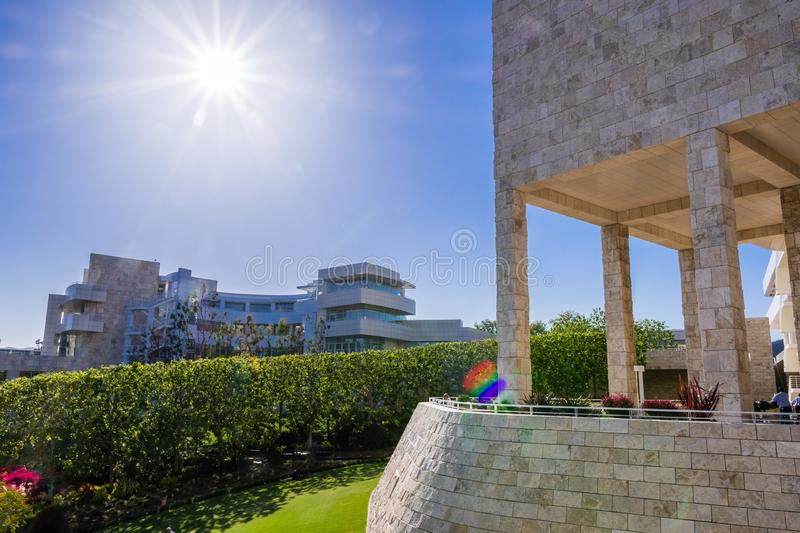 June 8, 2018 Los Angeles / CA / USA - Landscape at modern Getty Center; medieval looking colonnade and walls covered in travertine. In the foreground; designed stock photo
