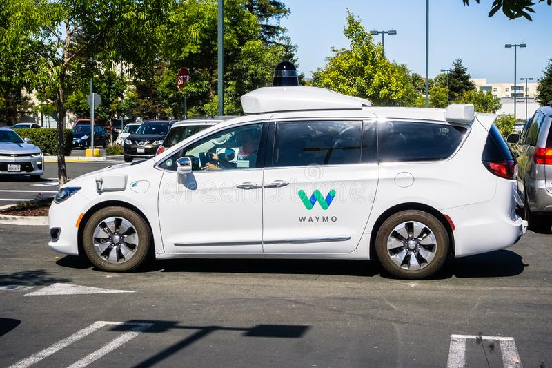 June 21, 2018 Mountain View / CA / USA - Close up of Waymo self driving car performing tests in a parking lot near Google`s stock photos