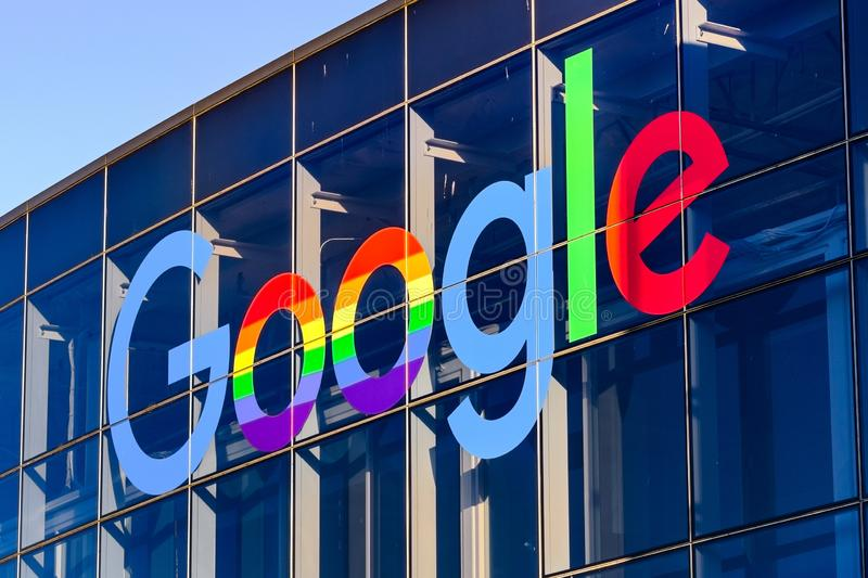 June 8, 2019 Mountain View / CA / USA - Google logo displayed in the Company`s campus in Silicon Valley. The `double o`s` are decorated in rainbow colors in royalty free stock images