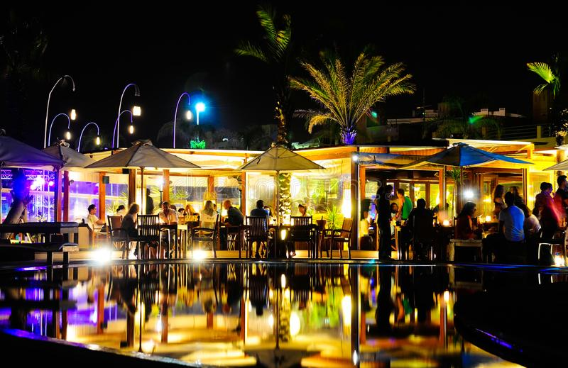Pool Terrace from Nightclub and Bar, Friends Having Fun at Dinner, Night Party. June, 2013, NoSoloÁgua Nightclub and Bar pool terrace, Portimão, Algarve royalty free stock photography
