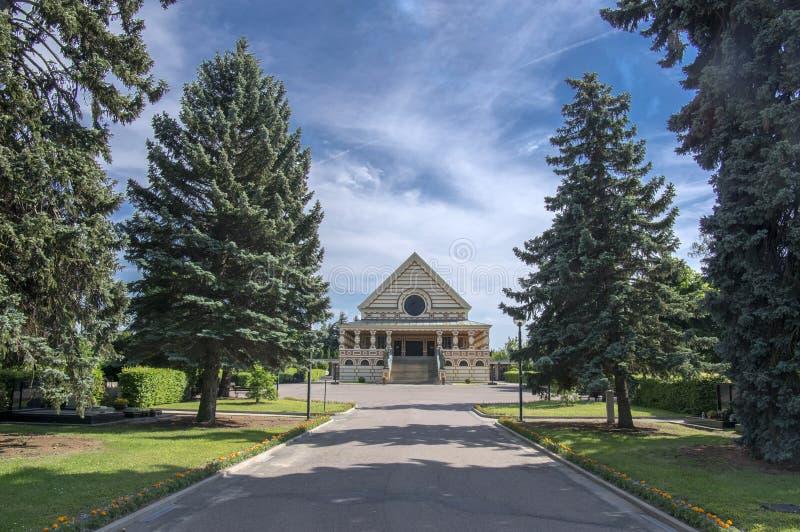June 3, 2017 Pardubice crematorium historic building built in Art Deco style. Conifer trees wide road stock photo