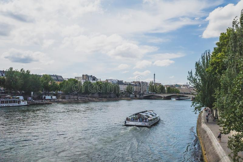 Tourist sightseeing cruise boat traveling down Seine stock photo
