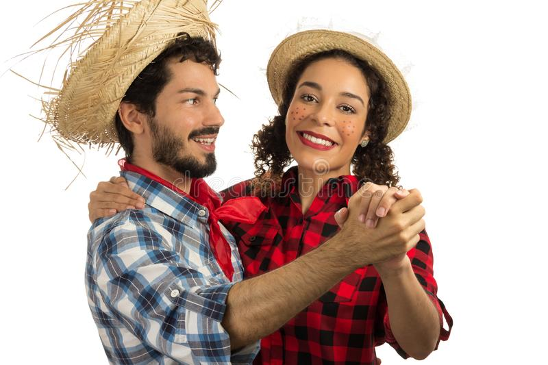 June Party is Festa Junina in Brazil.Cheerful couple is dancing to the traditional songs of June party. Man with beard and woman stock photo