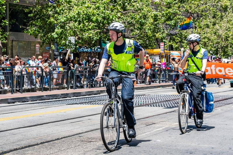 June 30, 2019 San Francisco / CA / USA - Emergency medical services EMS personnel biking on the SF Pride Parade route on Market royalty free stock photography
