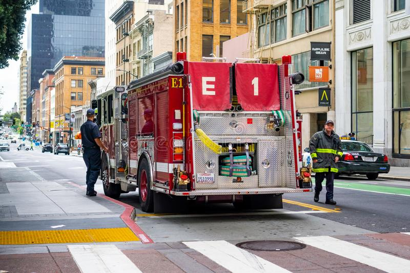 June 30, 2019 San Francisco / CA / USA - Firefighter engine parked close to Market Street during the SF Pride Parade in downtown stock photo