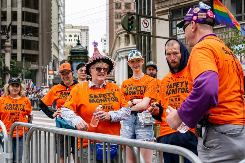 June 30, 2019 San Francisco / CA / USA - A group of people which provide monitoring at the SF Pride Parade on Market Street in royalty free stock photo