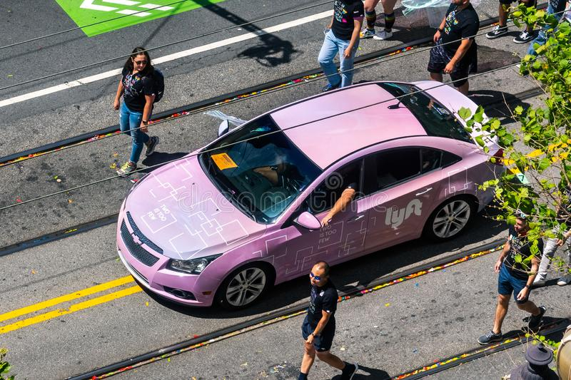 June 30, 2019 San Francisco / CA / USA - Lyft taking part at the SF Pride Parade on Market Street in downtown San Francisco stock image