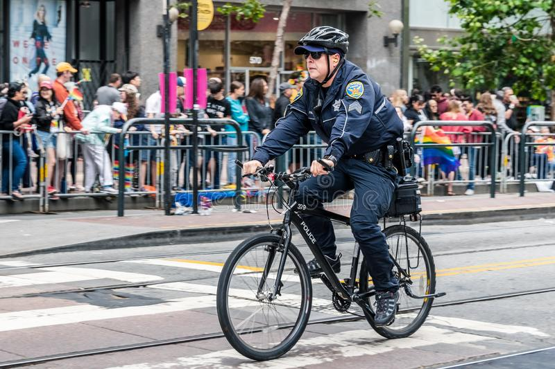 June 30, 2019 San Francisco / CA / USA - Police officer patrolling on bike the SF Pride Parade route right before the start; royalty free stock images