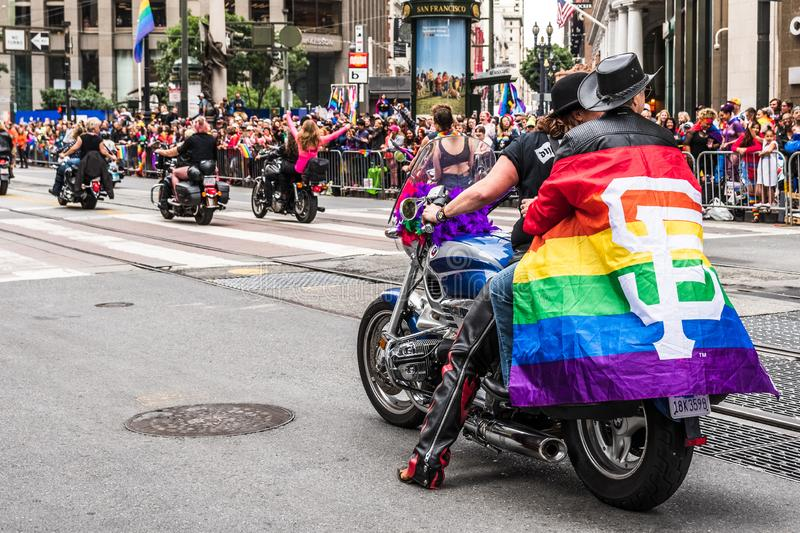 June 30, 2019 San Francisco / CA / USA - Unidentified participants at the SF Pride Parade riding on bikes and carrying the Gay royalty free stock photo