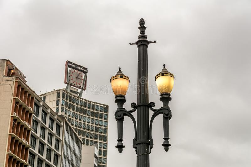 Old street lamp, symbol of the city of Sao Paulo, Brazil, with t royalty free stock images